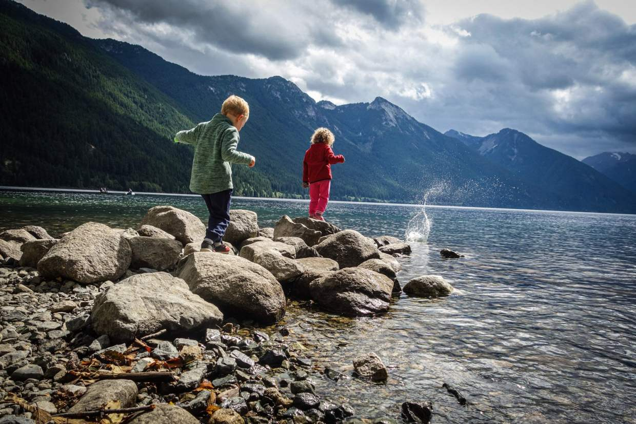 The kids throwing rocks into the water at Chilliwack Lake – seconds before A fell in with her only good running shoes that we brought that weekend.