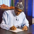 President Buhari: writing a letter