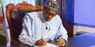 President Buhari: writing a letter
