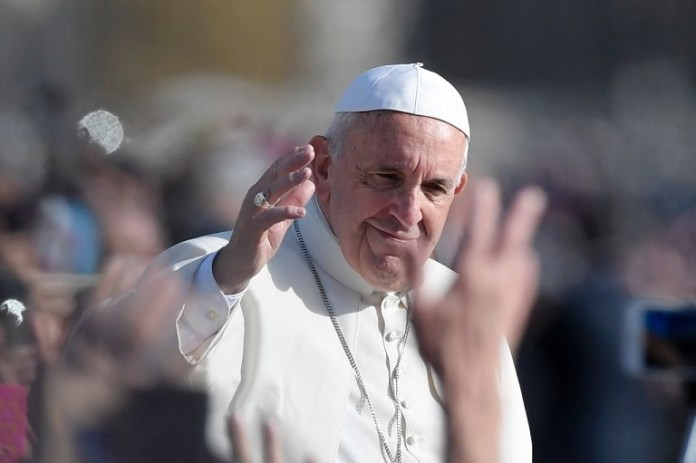 FILE PHOTO: Pope Francis says he praying fro French Catholics following Notre Dame fire