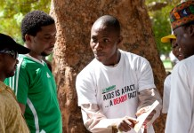FILE PHOTO: A healthcare giver sensitizing people on HIV/AIDS