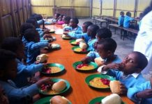 Pupils enjoying Home Grown School Feeding lunch
