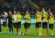 Dortmund players applaud the fans after their defeat