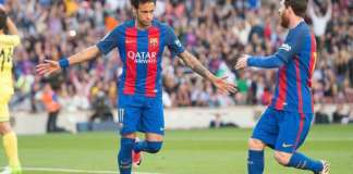 Neymar and Lionel Messi celebrate after Barcelona score against Villarreal