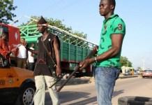 FILE: Civilian JTF members mount a roadblock in Maiduguri, Borno State