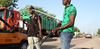 FILE: Civilian JTF members mount a roadblock in Maiduguri, Borno State