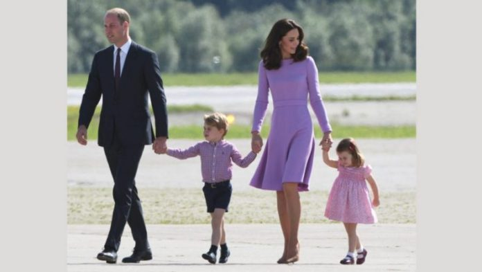 Britain's Prince William, Duke of Cambridge and his wife Kate, the Duchess of Cambridge, and their children Prince George and Princess Charlotte