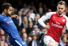 Cesc Fabresgas of chelsea battles for the ball