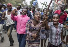 police use tear gas to disperse opposition protesters