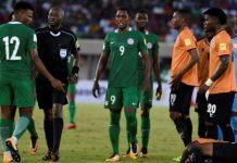 Botswanan referee Joshua Bondo (2L) speaks with Nigeria's midfielder Abdullahi Shehu (L) during the FIFA World Cup 2018 qualifying football match between Nigeria and Zambia