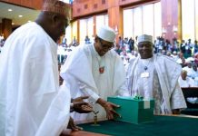 FILE: President Muhammadu Buhari (C) presenting copies of the 2017 budget documents to the National Assembly December 14, 2016.