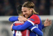 Basel defender Michael Lang celebrates scoring against Manchester United