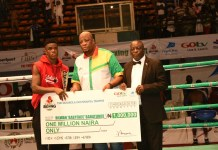 "FILE: Rilwan ""Baby Face"" Babatunde receiving cheque a of one million naira from Martin Mabutho, General Manager (Marketing and Sales), MultiChoice Nigeria; and Dr. Rafui Ladipo, President, NBBof C, at GOtv Boxing Night 14"
