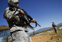 FILE: United States National Guard troops patrol along the US and Mexico border in Nogales, Arizona October 8, 2010. Photo: REUTERS
