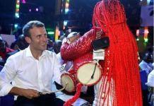 French President Emmanuel Macron drumming at the Afrika Shrine in Ikeja, Nigeria
