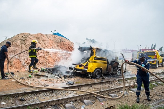 LASEMA officials tried to salvage the burning commercial bus