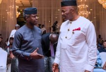Acting President Yemi Osinbajo Chats with Senate Minority Leader and Former Governor of Akwa Ibom State, Godwill Akpabio during the National Social Investment Program held at the State House in Abuja
