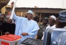 FILE: President Muhammadu Buhari casting his vote