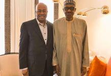 Niger Delta Minister Godswill Akpabio and President Muhammadu Buhari