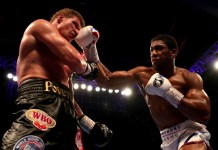 Anthony Joshua knocks out Alexander Povetkin in the seventh round of their heavyweight fight in Wembley