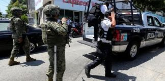 Police officers were detained and stripped of their guns, radios and bullet-proof vests