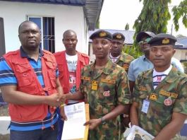 FILE: Nigerian Navy handing over document of a vessel to EFCC