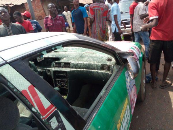 An APC vehicle damaged by PDP thugs in Ilorin, Kwara