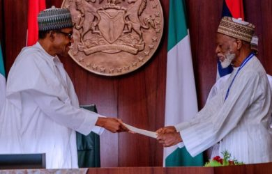 Founding chairman of PDM, Dr Farouk Abdulaziz hands President Muhammadu Buhari PDM's endorsement letter