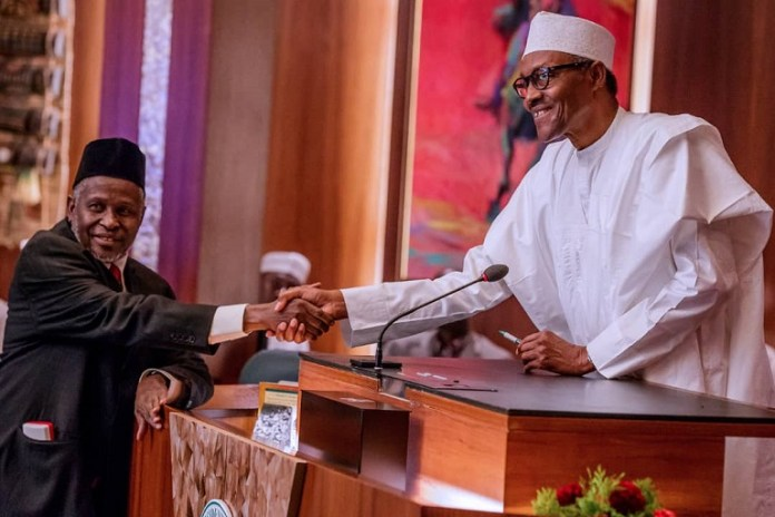 President Muhammadu Buhari after swearing-in acting CJN Ibrahim Tanko Muhammad