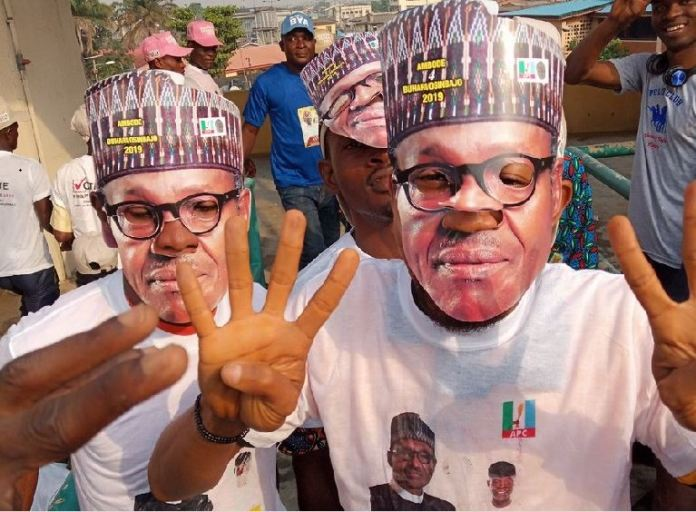 Supporters of President Buhari wearing a mask face at the Lagos Presidential Mega Rally
