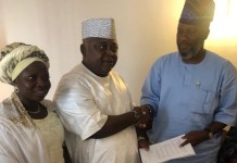 Hon. Adekunle Akinlade and Hon. Oladipupo Adebutu seals their pact with a handshake