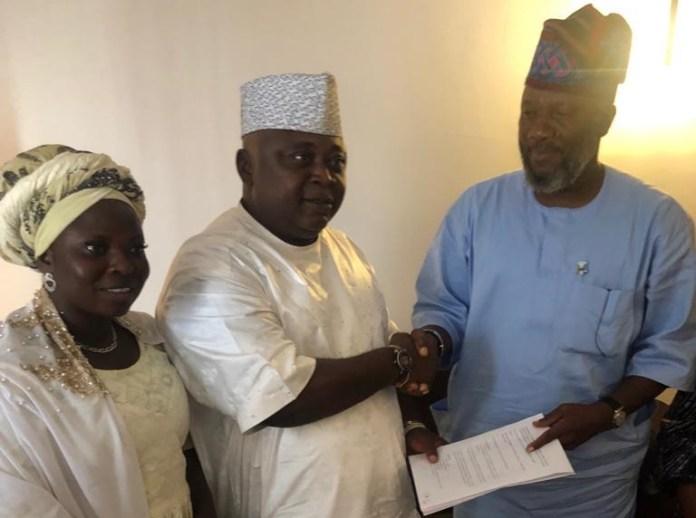 Hon. Adekunle Akinlade and Hon. Oladipupo Adebutu seals their pact with a handshake
