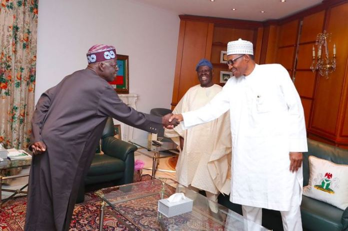National leader of the APC, Asiwaju Bola Tinubu shake hands with President Muhammadu Buhari