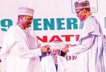 Prof. Mahmood Yakubu presenting President Muhammadu Buhari with his Certificate of Return