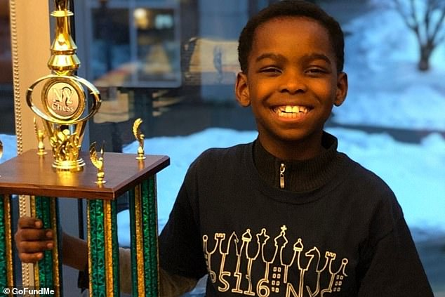 Tanitoluwa Adewumi pictured with his trophy after he won the state tournament for kindergarten through third grade last weekend