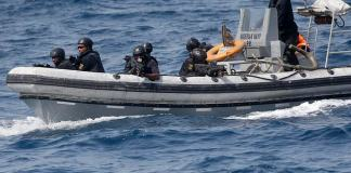 In this photo taken on Wednesday March 20 2019. Nigeria Naval Special Forces patrol during a joint navy exercise, in the Gulf of Guinea. pirates