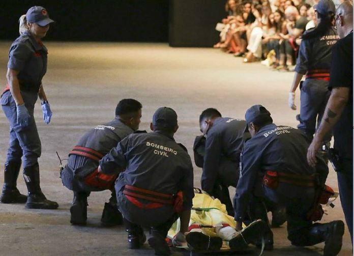 Model Tales Soares is taken from the catwalk by paramedics after he collapsed during Sao Paulo Fashion Week in Sao Paulo, Brazil, Saturday, April 27, 2019
