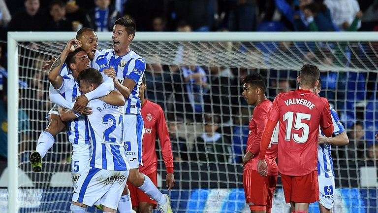 Leganes players celebrate scoring against Real Madrid on Monday