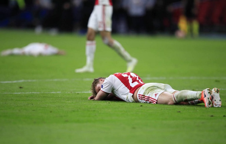 Ajax players dejected after crashing out against Spurs