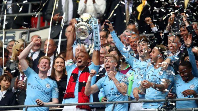 Manchester City captain Vincent Kompany lifts the FA Cup