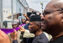 Vice President Yemi Osinbajo flanked by Gov. Rivers State, Ezenwo Nyesom Wike as he cuts the ribbon on commissioning the Liquid Waste Treatment Plant in Port-Harcourt