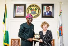 Lagos State Governor, Mr. Governor Babajide Sanwo-Olu (left), presents a plaque to British High Commissioner, Catriona Laing during her courtesy visit to the Governor at the Lagos House