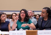 """Rashida Tlaib (centre), who responded by calling Trump """"a lawless and complete failure of a president"""", with Alexandria Ocasio-Cortez (left) and Ayanna Pressley (right)"""