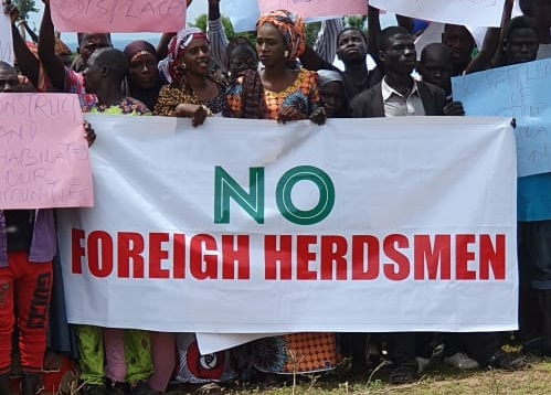 Adamawa residents kick against RUGA with No Foreign Herdsmen placard but welcome NLTP