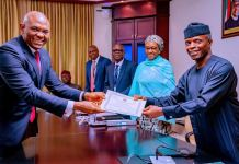 Tony Elumelu receives Transcorp Hotel's Certificate of Discharge from Vice President Yemi Osinbajo
