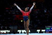 Simone Biles of the U.S. celebrates on the floor
