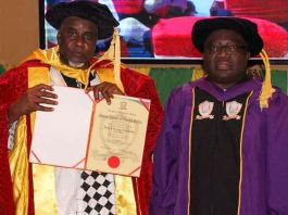 Alhaji Abdulmunaf Yunusa Sarina, President and Chief Executive Officer of Azman Group, and Professor Gregory Iyke Ibe, Chancellor and Founder of Gregory University, at the conferement of doctorate degree on Sarina at the university in Uturu, Abia State