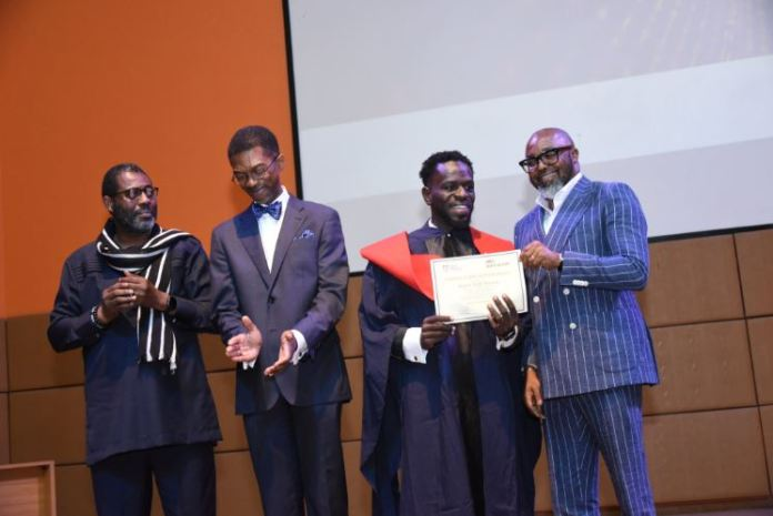 Edmund Asamoah presented his certificate by MultiChoice Nigeria MD, John Ugbe
