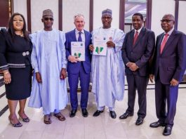 Governor Abubakar Bello and Mr Roel van Neerbos after the signing of the backward integration initiative MoU