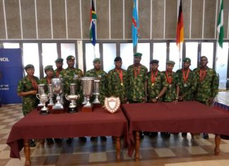 Nigerian Armed Forces pose with their medals and trophies